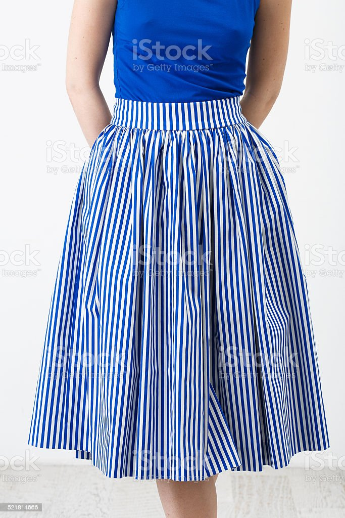 Woman in the blue stripes skirt stock photo
