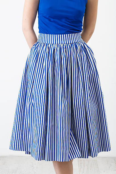 woman in the blue stripes skirt - preppy fashion stock photos and pictures