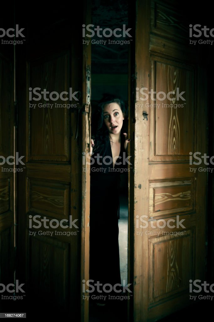 Woman in the door space royalty-free stock photo