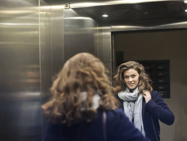 Woman in the elevator stock photo