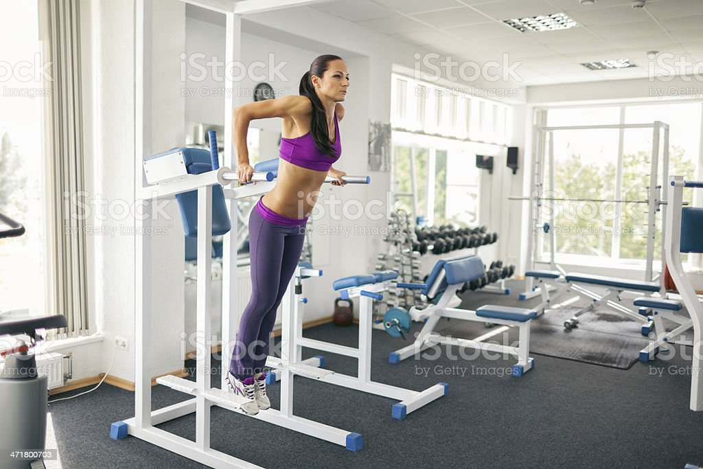Woman in the fitness club stock photo