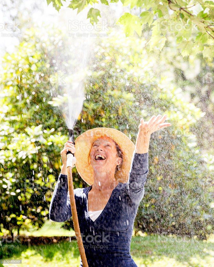 Woman in the Garden having Fun stock photo