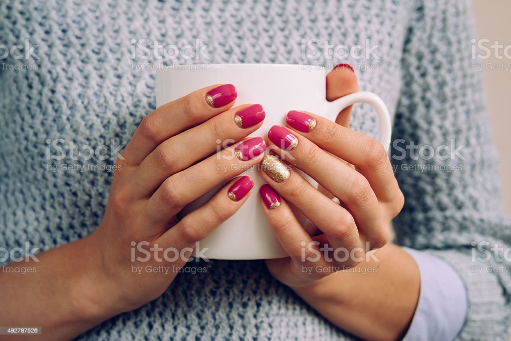 Woman in the gray sweater holding in her hands stock photo