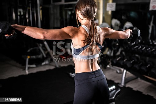 884865956istockphoto Woman in the gym 1162555983