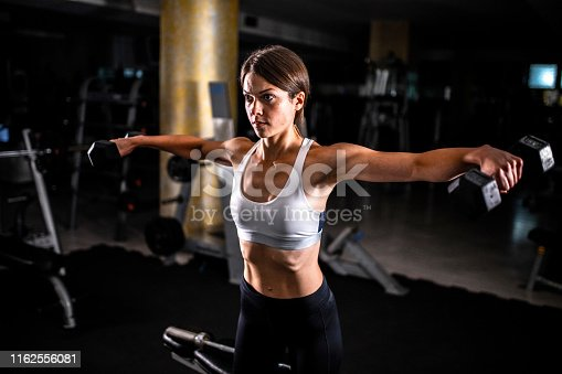 884865956istockphoto Woman in the gym 1162556081