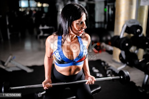 884865956 istock photo Woman in the gym 1162556399