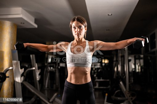 884865956 istock photo Woman in the gym 1162556418
