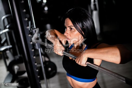 884865956 istock photo Woman in the gym 1162556593