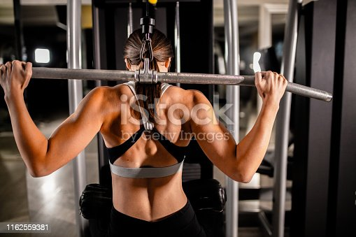 884865956istockphoto Woman in the gym 1162559381