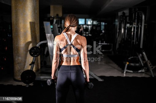884865956istockphoto Woman in the gym 1162559438