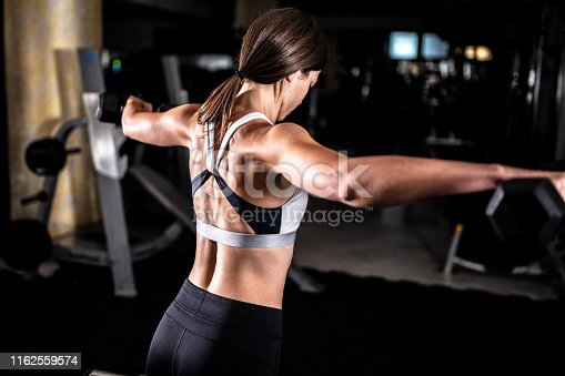 884865956istockphoto Woman in the gym 1162559574