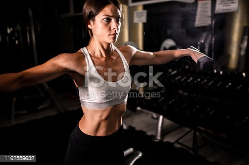 884865956 istock photo Woman in the gym 1162559632