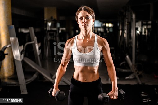 884865956 istock photo Woman in the gym 1162559646