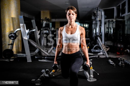 884865956istockphoto Woman in the gym 1162559712