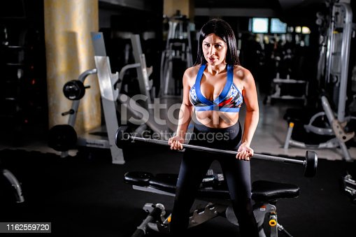 884865956 istock photo Woman in the gym 1162559720