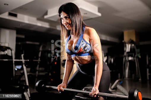 884865956istockphoto Woman in the gym 1162559801