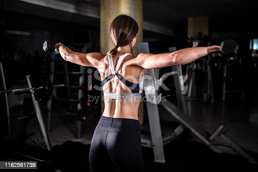 884865956 istock photo Woman in the gym 1162561739