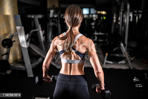 884865956istockphoto Woman in the gym 1162561874