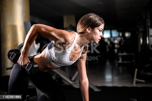 884865956istockphoto Woman in the gym 1162561884