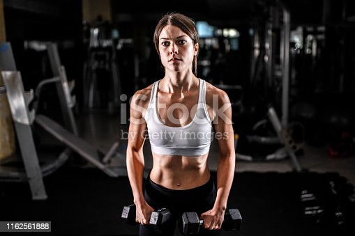 884865956 istock photo Woman in the gym 1162561888