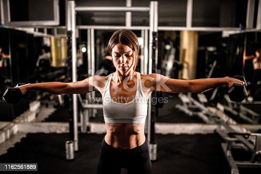 884865956istockphoto Woman in the gym 1162561889