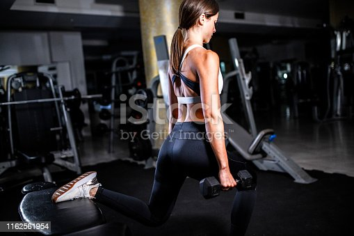 884865956 istock photo Woman in the gym 1162561954