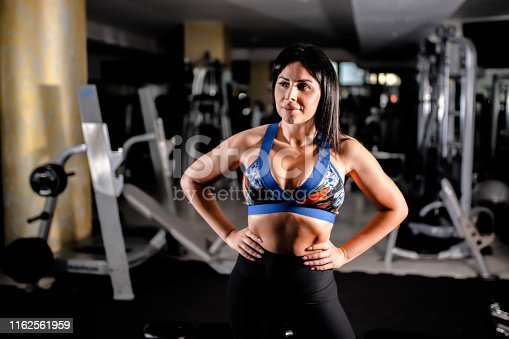 884865956 istock photo Woman in the gym 1162561959