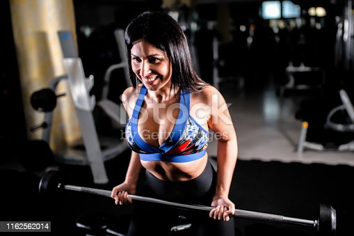 884865956istockphoto Woman in the gym 1162562014