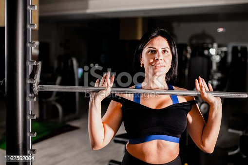 884865956 istock photo Woman in the gym 1162562064