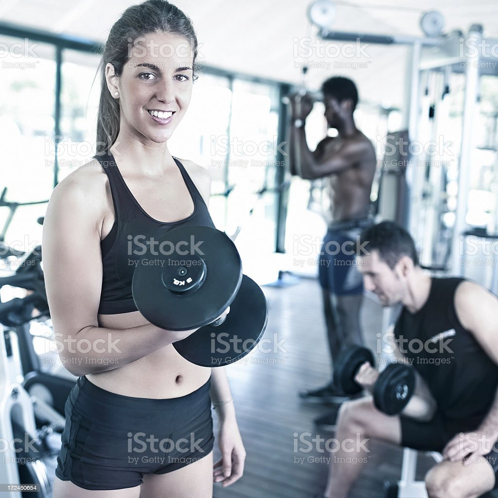 Woman in the gym royalty-free stock photo