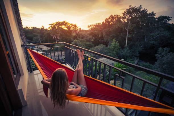 Woman in the hammock stock photo