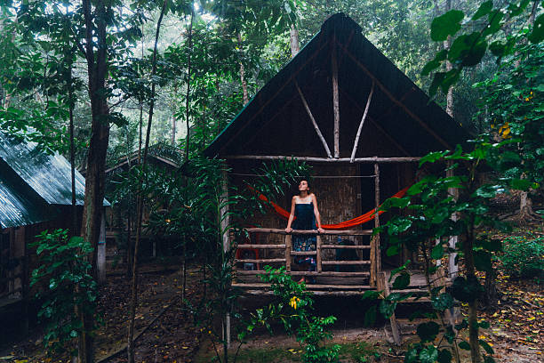 woman in the hut in the jungles - 自然旅行 ストックフォトと画像