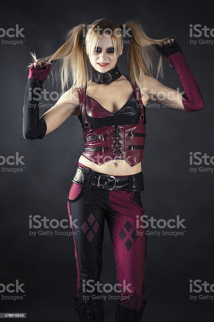 woman in the image of the mad a harlequin stock photo