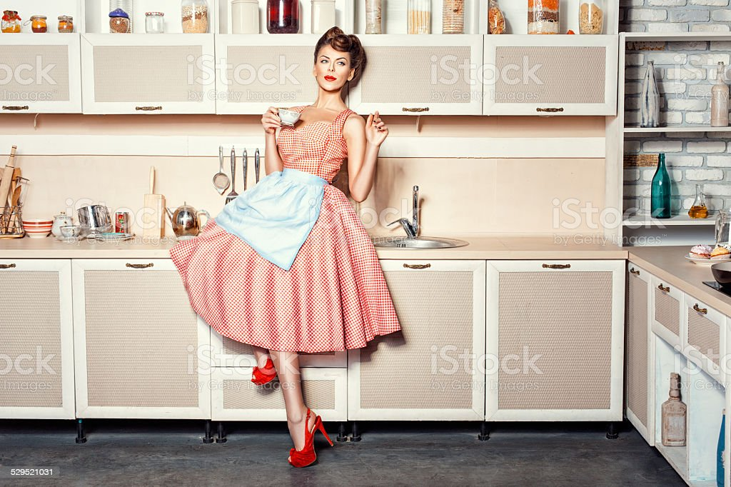 Woman in the kitchen. stock photo