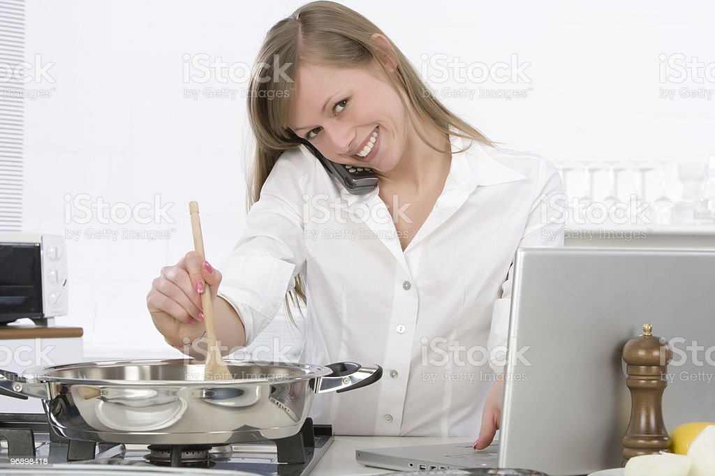 woman in the kitchen with computer royalty-free stock photo