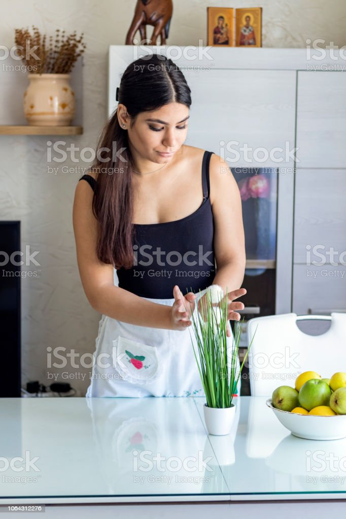Woman in the Kitchen with Wheatgrass stock photo