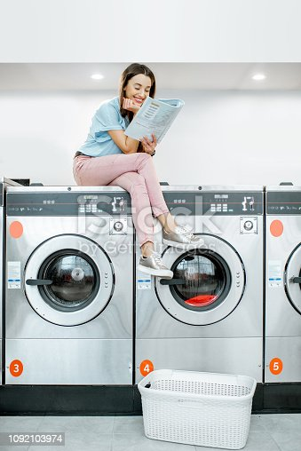istock Woman in the laundry 1092103974