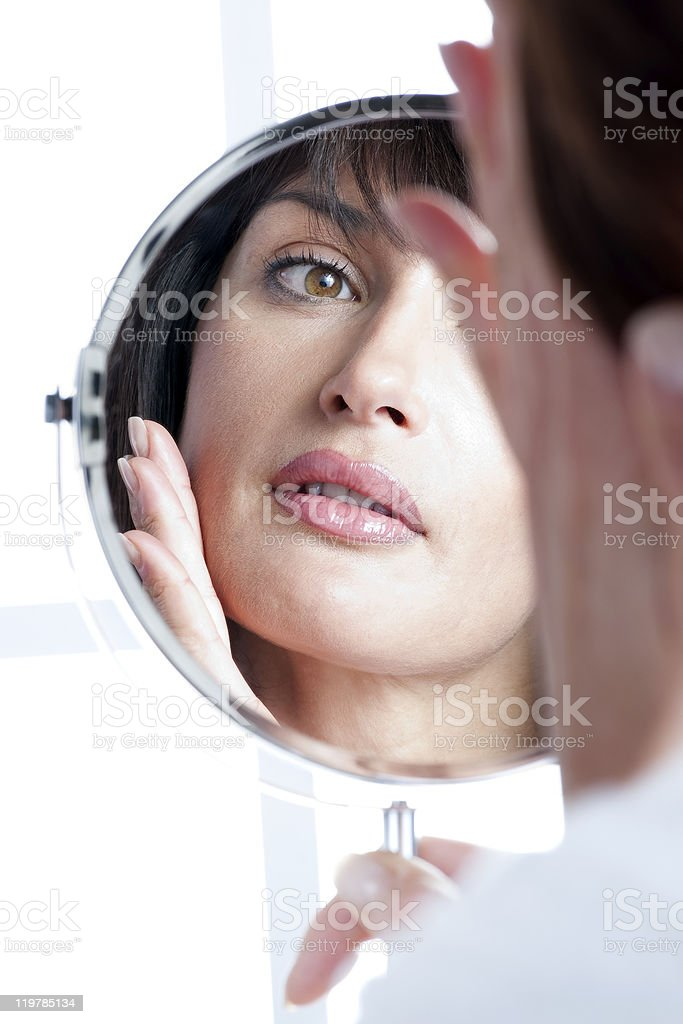 Woman In The Mirror royalty-free stock photo