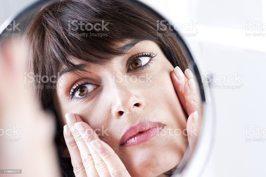 Woman In The Mirror stock photo