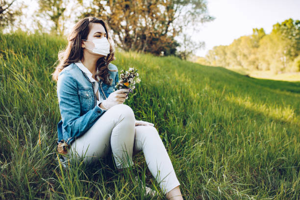 Woman In The Nature Wearing Protective Face Mask stock photo