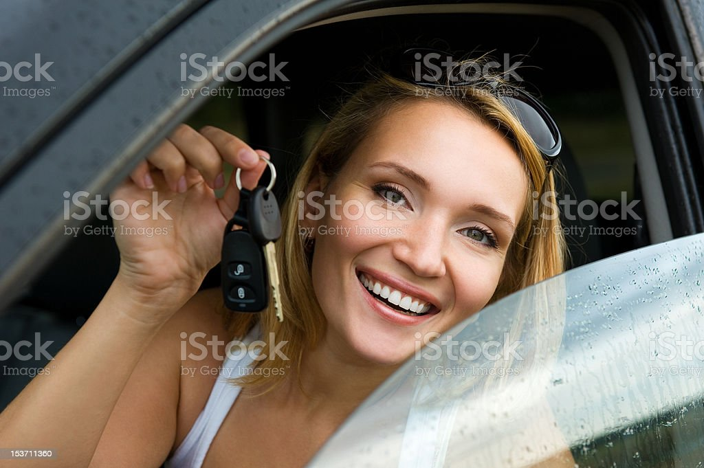 woman in the new car with keys royalty-free stock photo