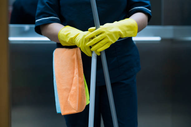 woman in the office with cleaning implements - custodian stock pictures, royalty-free photos & images