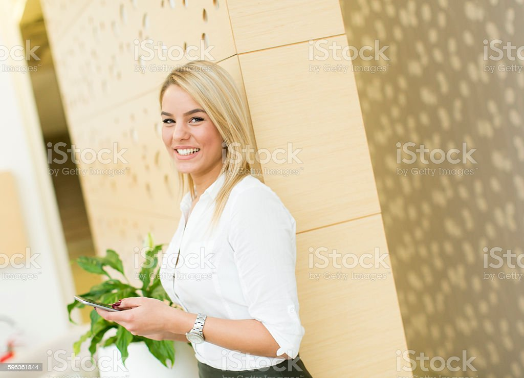 Woman in the office with phone royalty-free stock photo