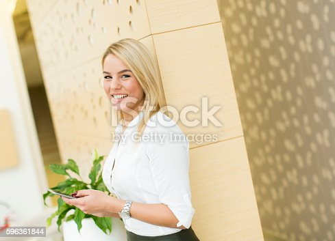 Woman In The Office With Phone Stock Photo & More Pictures of Adult