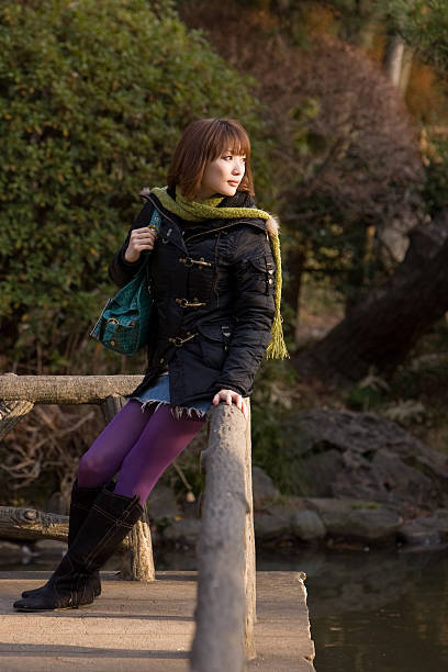 Woman in the park (late afternoon) stock photo