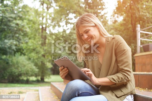 917307226 istock photo Woman in the park. 625738634