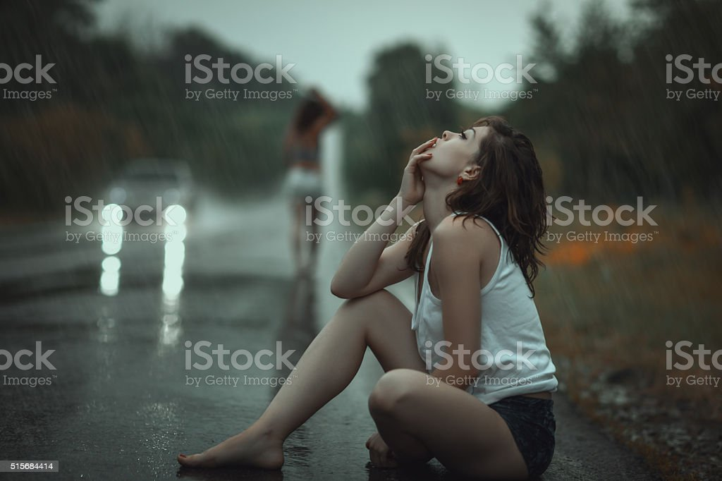 Woman in the rain and sad. stock photo