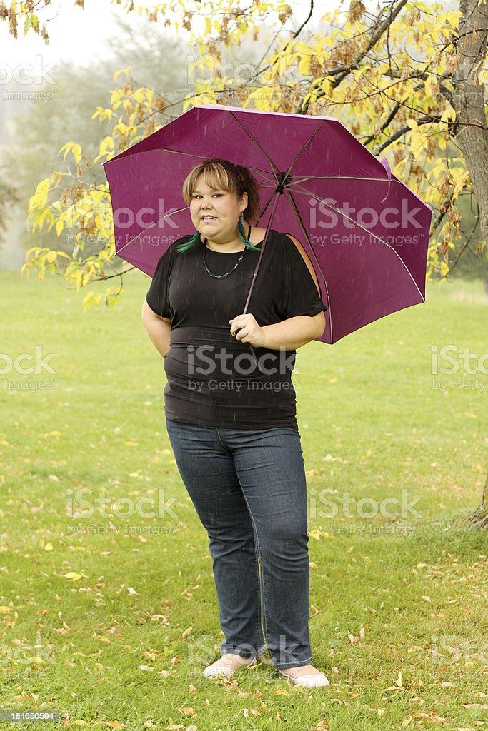 Woman In The Rain stock photo