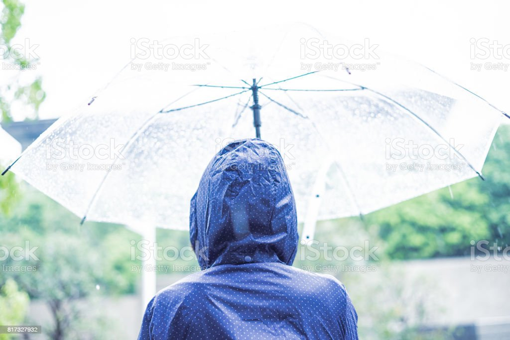 Woman in the rain stock photo