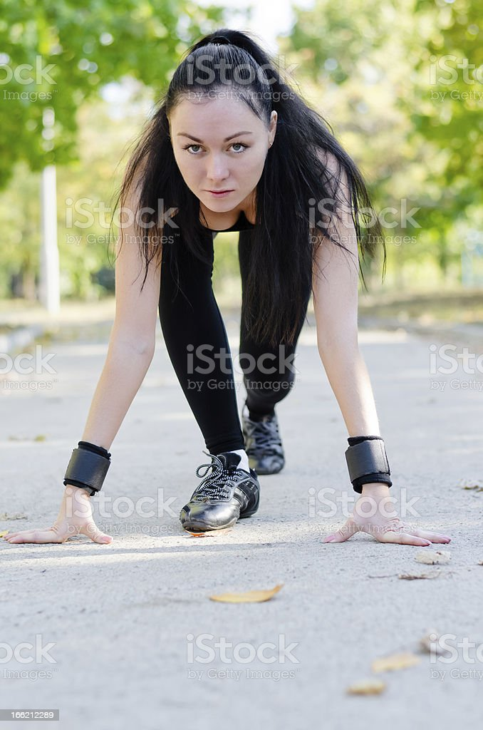 Woman in the starting position for a run royalty-free stock photo